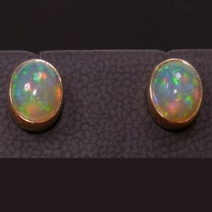 14K yellow gold opal earrings available at John Wallick Jewelers in Sun City, Arizona near Phoenix, AZ