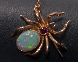 Vintage Opal and Garnet Spider Pin at John Wallick Jewelers in Sun City, Arizona near Phoenix, AZ
