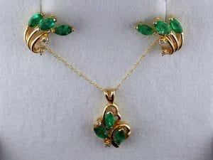 Emerald and Diamond Earrings and Pendant Set available at John Wallick Jewelers, in Sun City, Arizona