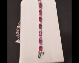 Oval Ruby Silver Bracelet available at John Wallick Jewelers in Sun City, Arizona near Phoenix, AZ
