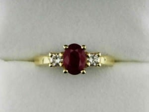 Diamond and oval ruby ladies ring available at John Wallick Jewelers, in Sun City, Arizona, near Phoenix, AZ
