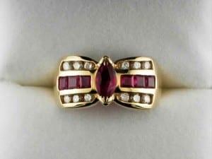 Marquise cut ruby ring with diamonds and princess cut rubies available at John Wallick Jewelers, in Sun City, Arizona, near Phoenix, AZ