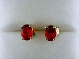 Mexican fire opal earrings oval in yellow gold available at John Wallick Jewelers, in Sun City, Arizona, near Phoenix, AZ