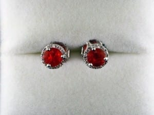 Mexican fire opal earrings round in white gold available at John Wallick Jewelers, in Sun City, Arizona, near Phoenix, AZ