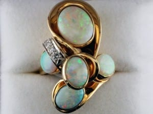 Opal custer ring available at John Wallick Jewelers, in Sun City, Arizona, near Phoenix, AZ