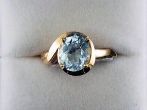 Oval Cut Aquamarine in-a 14k Yellow Gold Ring at John Wallick Jewelers, in Sun City, Arizona, near Phoenix, AZ
