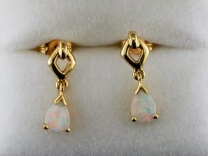 White opal dangle earrings in yellow gold available at John Wallick Jewelers, in Sun City, Arizona, near Phoenix, AZ