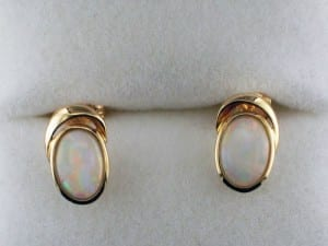 White oval opal earrings in yellow gold available at John Wallick Jewelers, in Sun City, Arizona, near Phoenix, AZ